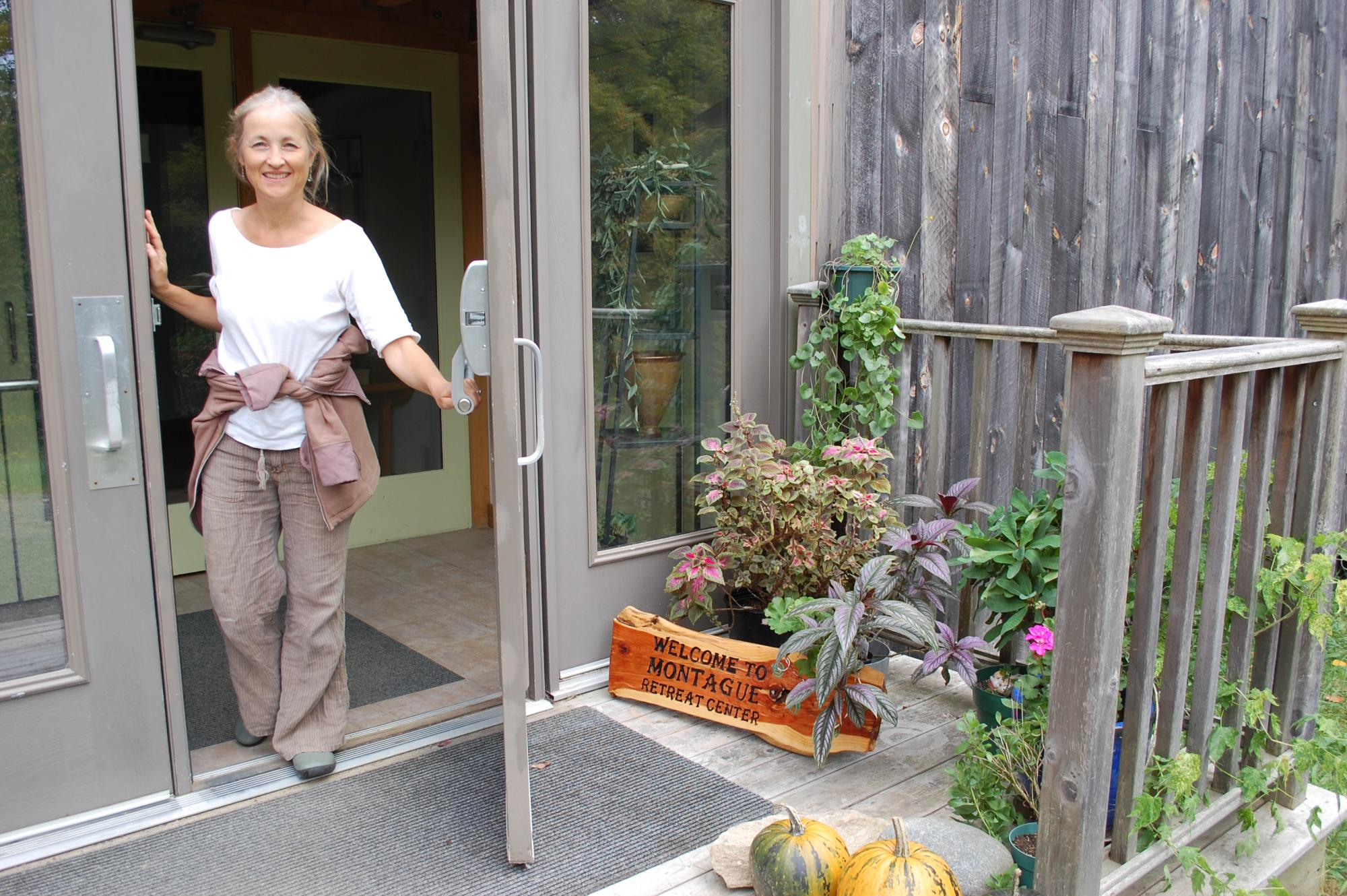 New owner Beth Jacobson opens the front door of the main conference building at Montague Retreat Center.
